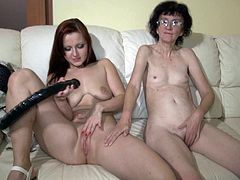 Lustful redhead sexpot fucks her old lesbo granny with strapon