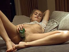 Drunk blonde decides to use a beer bottle to please herself. This nasty whore will do anything to get off and will drink and screw anything!