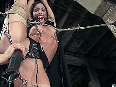 Hot dark-haired bitch Wenona is having fun with some dominant chick in a basement. She allows the mistress to tie her up and then loves having dildos in her cunt and asshole.