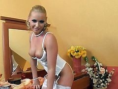 Blonde Kathia Nobili spends her sexual energy alone using sex toy