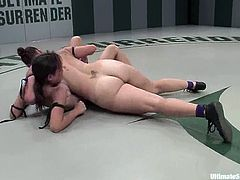 Nude lesbians Amber Rayne and Bella Rossi are having a scuffle on tatami. They wrestle with each other energetically and then the winner fucks the loser's cunt with a strapon.
