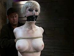 Ivory-skinned blonde Cherry Torn is getting naughty with some man in a basement. She allows the guy to tie her up and then gets her coochie toyed to an orgasm.