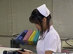 Cute Japanese girl looks extremely seductive wearing nurse uniform. She plays with her coochie right in front of her coworker.
