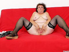 She's hot and she's saggy, meet our Czech old slut Marsa and find out what she's up to! This saggy whore feels horny as hell so she doesn't spares her time and gapes her juicy pussy before filling it with her dildo. See her moaning as she slides the sex toy deep in her pussy and much more. Enjoy