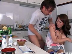 She was busy in the kitchen cooking a meal when this guy checked her out. He had a crave but not for her food. The dude started to grope her big boobs and than served her his special sausage delight. Yeah, Rika loved how he cooks his weenie between her boobs!