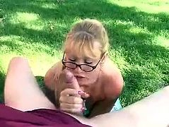 Clarisse shows off her boobs in a backyard. She gives a blowjob standing on her knees and also gets facialed.