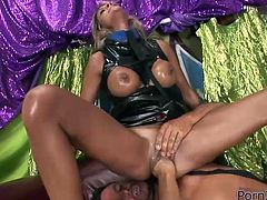 Raunchy blonde hooker with big boobs is greased up in oil. While standing on her all four she gets drilled deep in her cunt with fist. Damn, her cunt is stretched wide as hell. Check this out at anysex.com