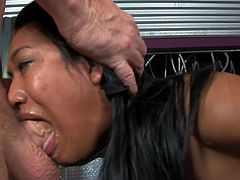 Kinky Asian girl gives a blowjob to some big cocked biker. Then he starts to fuck Lyla deep in her mouth. Then she gets her face covered with big load of cum and spit.