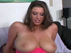 Busty brunette sexpot rides her man's dick in reverse cowgirl position