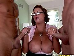 Stunning cougar with huge boobs stands on her knees and gives a blowjob to two big cocked guys. After that she also gets rammed in her wet pussy.