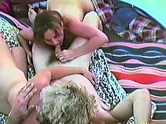 Two guys and two chicks have a picnic outside the town. After some time it turns to wild group sex. Girls suck big dicks and then get their pussies fucked hard.