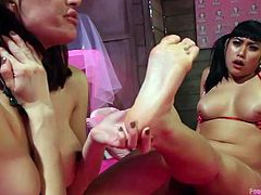 These lesbians are getting kinky with each other's cunts. The sexy and cute Mai shoves her toes into her girlfriend's pussy and then she returns the favor. Her toes curl as she gets foot fisted. Watch then get kinky.
