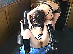 Two slim dark-haired girls are having lesbian fun indoors. They kiss and lick each other's snatches and then fuck them hard with a dildo.