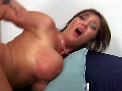 Tanned short haired brunette Claire Dames with enormous firm rack and round ass has memorable screaming orgasms while younger stud with sixpack is pounding her in doggy style position.