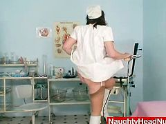 Hot tempered overaged nurse in steamy lingerie and stockings finds a dildo in a cupboard, so she decides to try it out right in the medical room. She gets on a gynecological chair in order to poke her shaved punani with dildo in steamy sex video by Naughty Head Nurse.