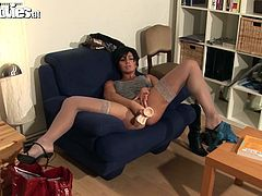 Ficki puts on her stockings carefully and then her high heels. She looks good and likes it! The Austrian broad then goes and grabs her favorite white dildo. She makes herself comfortable on the armchair, spreads her thighs and slowly pulls over her panties. She's turned on and that dildo is the right tool for her