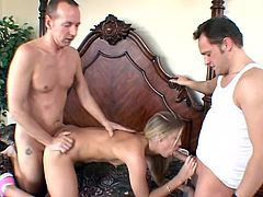 Two horny fuckers shove their dicks balls deep into this fuckin' bitch's holes, one in her cunt and another in her pussy, check it out!