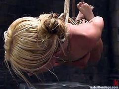 She's blonde, pretty and fragile but that doesn't means she won't be putted on ice! This sexy chick named Bianca is all tied up and hanged like a whore. Then, she is lowered on a big block of ice that's too much for her body Her tits enter in contact with the ice and she begins to scream with pain!