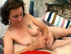 This tattooed mature Pandora ask her husband to film her while he giving him handjob. He agreed to this but they didnt expect that video will becomes public