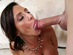 This insatiable Milf does not only fuck a young cock, but also rubs her hairy cunt with a vibrator. The fuckfest ends with cumshot in her mouth.