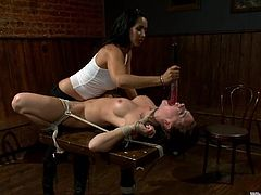Stunning brownie gets undressed and tide up in the empty bar by Isis Love. She gets clothespinned and covered with hot wax. Later on she also gets toyed with a strap-on.