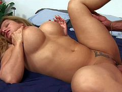 Bored cheating and cheep looking milf with big ass and huge firm gazongas brings home two experienced studs with long meaty sausages and gets fucks with them in casual threesome.
