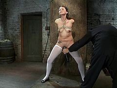 Lovely girl in stockings gets tied up in some barn. Then she gets her nice ass spanked. Then this babe also gets her pussy toyed with a vibrator.