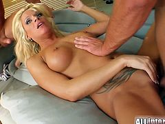 Have a look at this hardcore scene where this slutty blonde's fucked silly by a guy with a large cock.