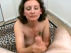 Entertain yourself by watching this mature lady, with big natural knockers and a hairy pussy, while she touches herself and serves a blowjob!
