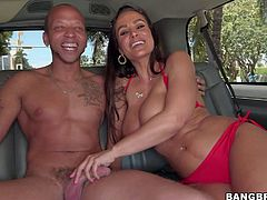 Famous long haired brunette whore Lisa Ann with enormously big firm knockers and provocative sun glasses takes off denim skirt and bikini for black dude on bask seat in his car.