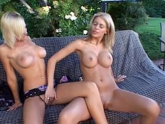 Playful lesbians take lingerie off and show off their amazing bodies lying on a sofa in a backyard. Later on they lick dildos and start to toy each other.