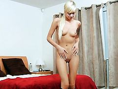 Extremely sexy tramp Emma Mae strips down to her bare skin to play with herself naked