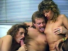 Two horny blonde bitches are trying hard to satisfy some guy. They suck and rub his boner devotedly and then fuck the man in cowgirl and reverse cowgirl positions.