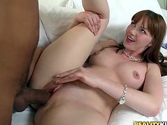 A redhead cutie with blue eyes and tight body sucks on a hard dick and gets her fuckin' gash stuffed with the very same hard dick!