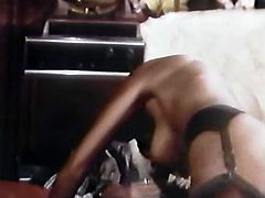 Wearing a beautiful lingerie set with pantyhose and garters, sex-starved ebony whore lusts for pleasure. She pleases her lover with a blowjob. Then he fucks her juicy pussy in missionary position.