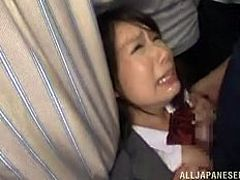 This cute Japanese schoolgirl is walking home when she is approached by two men who want to fuck her. They rub her pussy and suck on her nipples. They make her suck their dicks sloppily until they shoot their sticky cum.