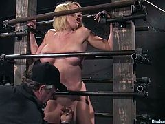 Busty blonde Krissy Lynn allows some guy put her into chains in a basement. The dude rubs Krissy's coochie with a toy and she soon cums.