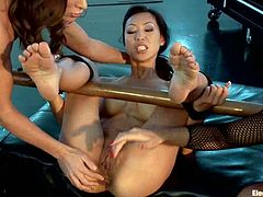 These chicks know how to humiliate this divine siren Tia Ling! They tie her legs up on the spreaders and wires her pussy, vibrating it at a time.
