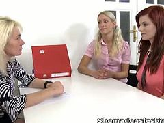 Gloria is brought into a room with a sexy blonde and this woman guides Gloria and her friend to share each other sexually. Gloria, a sexy blonde begins kissing her redhead friend and starts her lesbian time. Gloria's friend begins to lick her pussy wet and then turns to her breasts. They both take turns on each other licking each others breasts and pussies and soon three way action ensues. They spread each others legs wide open, use their fingers on each other, and give each other orgasmic endings. This is a wild lesbian naked adventure and Gloria is made a lesbian on this wild day and end it