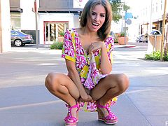 Take a look at this hot scene where a gorgeous teen by the name of Natasha pulling up her dress to play with her pink pussy in public.