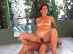 She saw her daughter boyfriend swimming naked at house pool and decided to join him and try to get hardcore sex. Dude let her to blow his hard cock before he pounded her hard