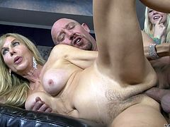 Erica Lauren, Will Powers and Tiffany Taylor B are having fun in the living room. Will makes the blonde mom suck his dick and then fucks her cunt in many positions in the presence of the blonde cutie.