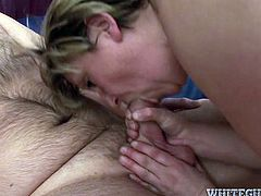 This old woman is a natural born cock sucker. She sucks his meat stick passionately paying special attention to his balls. Then she rides him in cowgirl position.