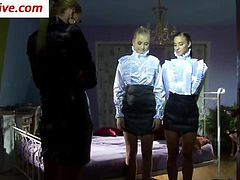 Domina dresses lesbos classy and gets them wam in fetish fun