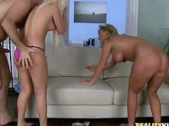 Gorgeous blonde girls fuck two big cocked guys on a sofa