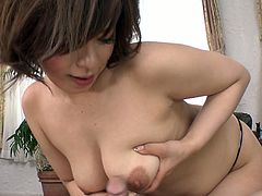 Short haired brown colored bitchy Asian bombshell tenderly licks hairy balls and hot blooded penis, tit fucks it a little and swallows it finally. Watch this Asian great cock sucker in Jav HD porn video!