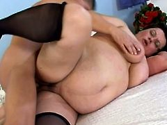 Salacious obese mature brunette Laszlone is having fun with some dude. She sucks and licks his dick greedily and then they fuck in side-by-side and missionary positions.