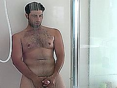 Handsome straight guy Johnny masturbating his enormous phallus in the shower