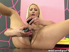 Sexy European milf Uma Zex spreads her legs and uses a douche to get her pussy nice and wet. She takes a purple vibrator to her cunt after she tears her pantyhose open. She shoves the vibrator deep inside and squirts pussy juice on the camera.