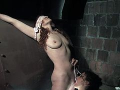Sabrina Fox gets tied up and blindfolded by her unmerciful mistress. She gets her ass whipped painfully and then she also gets her vagina hit with electricity.